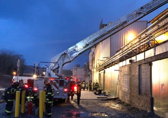 Firefighters access the roof during a fire Thursday at a paper mill in Pennsylvania. - Photo courtesy of Clarks Summit Fire Company