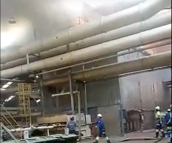 Lumber mill workers spot smoke developing above the production line in Argentina. - Screencapture Via Twitter