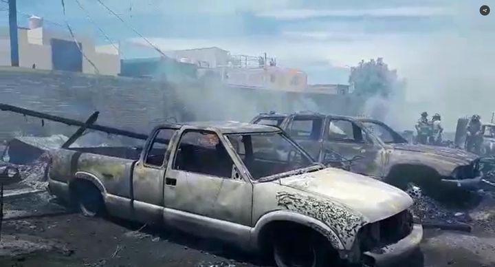 Vehicles consumed by flames in pallet factory in Mexico Wednesday. - Screencapture Via El Sol de Durango