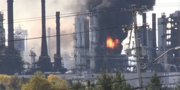 Flames shoot skyward from the interior of an oil refinery in Saint John, New Brunswick.