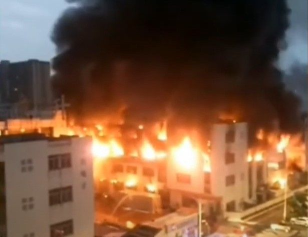 Flames engulf a plastics factory in Dongguan, China, Sunday. - Screencapture Via Twitter
