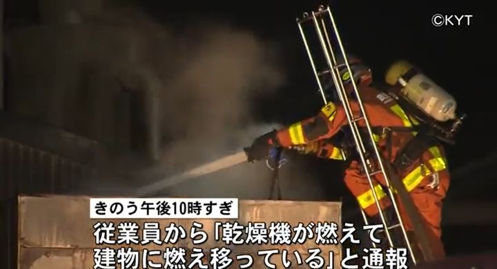Firefighter directs water down into a feed mill building in Japan destroyed by fire. - Screencapture Via KYT Television