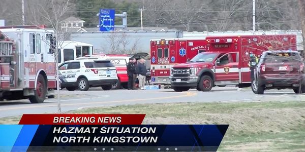 Responders gather outside a North Kingstown, Rhode Island, food processing plant.