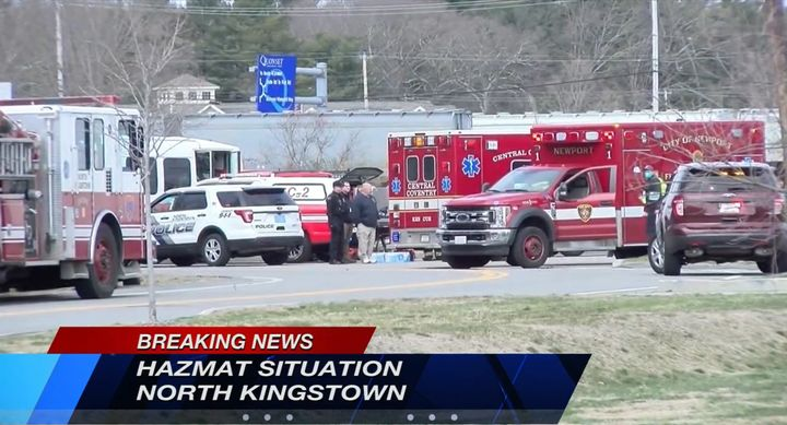 Responders gather outside a North Kingstown, Rhode Island, food processing plant. - Screencapture Via WPRI
