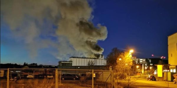 Smoke rises from a food processing plant on fire in Kulmbach, Germany.