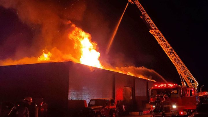 Flames break through the roof of a leather factory in Pomona, California. - Photo Courtesy of Los Angeles County Fire Department