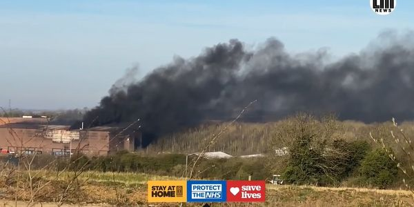 Smoke rises above an industrial park in Melton, England, Sunday.