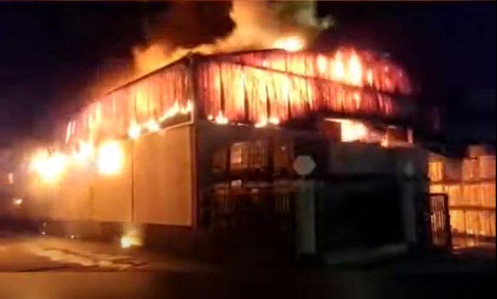 Fire guts a warehouse storing used cooking oil for recycling. - Screencapture from YouTube