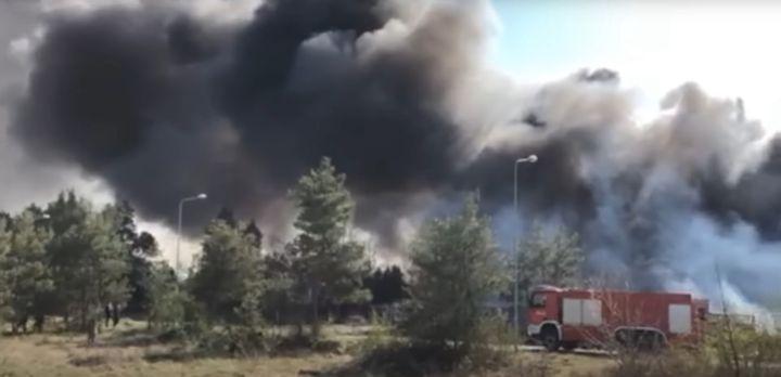 Dark smoke billows from a landfill in south central Poland Sunday. - Screencapture Via Polskie Radio