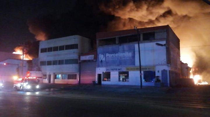 Flames spread behind the Mitras Garcia plastics factory in Garcia, Mexico. - Photo Courtesy of Protección Civil de Nuevo León