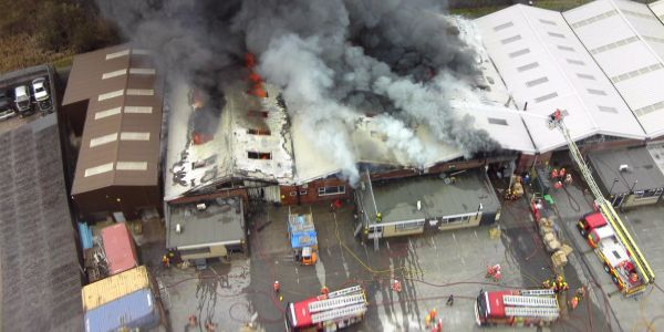 Three industrial buildings out of an industrial estate of seven were destroyed by fire in...