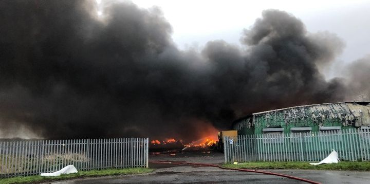 Choking smoke rises from baled plastic at a recycling plant in Cleveland, UK, Sunday. - Photo Courtesy of Cleveland, UK, Fire Brigade