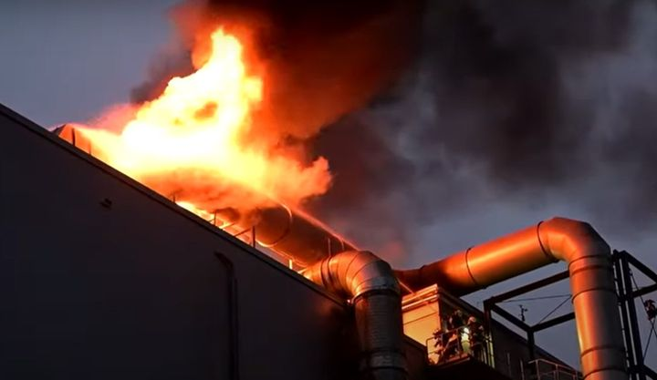 Firefighters battle a roof fire at a towering feed mill in east central Germany. - Screencapture Via MDR