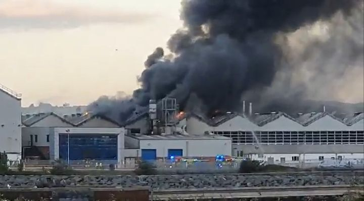 Smoke rises from the Bombardier Aerospace Plant in Belfast, Northern Ireland, Sundy evening. - Screencapture Via Belfast Live