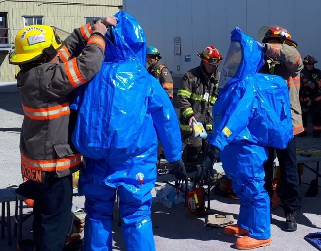 Haz mat responders suit up to enter a poultry processing plant in Ontario Sunday after leaking ammonia was detected. - Photo Courtesy of Brampton Fire & Emergency Services
