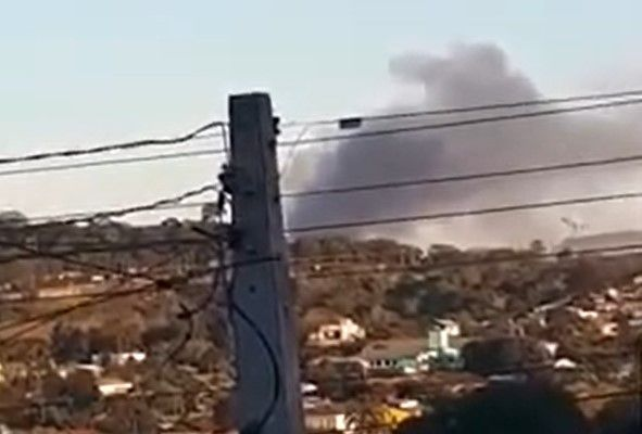 Heavy smoke rises from a burning mattress factory Monday in Brazil. - Screencapture Via YouTube