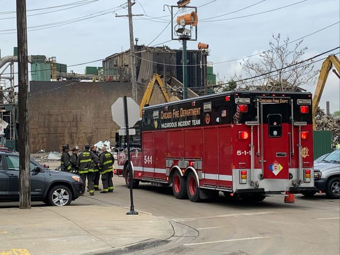 Chicago firefighters respond to an explosion Monday at a scrap yard. - Photo Courtesy of Bryan Hopkins
