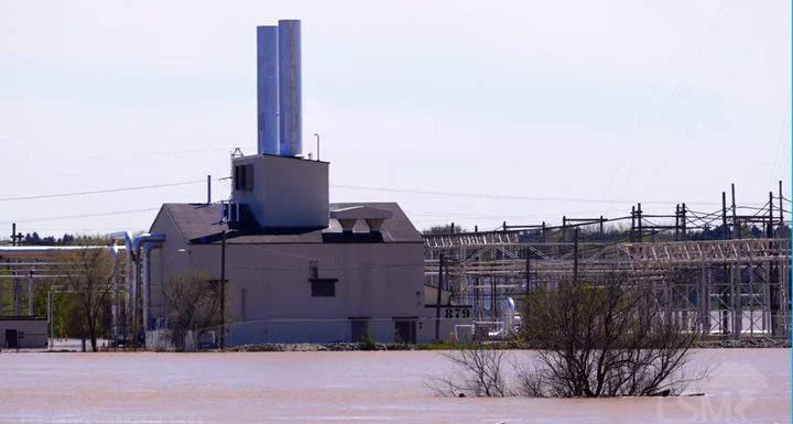 Dow Chemical's Michigan Operations site on the flooded Tittabawassee River. - Screencapture Via YouTube