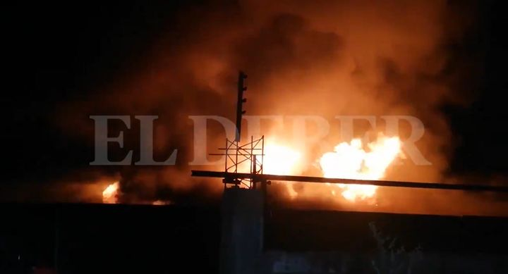 Flames rise from a plastic plant Monday in Bolivia. - Screencapture Via El Deber