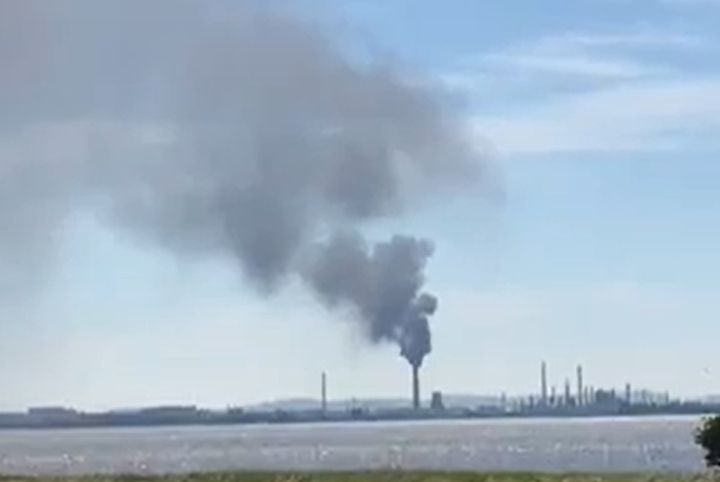 Safety flaring produced heavy smoke Wednesday at a refinery in the U.K. - Screencapture Via Liverpool Echo