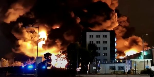 Flames billow above the burning Lubrizol chemical plant in September 2019.
