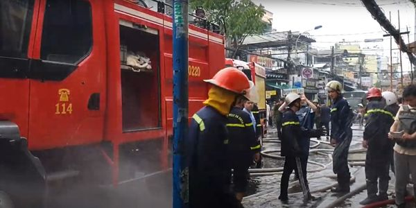 Rain soaked firefighters battled a shoe factory fire Wednesday in Vietnam.
