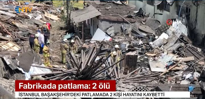 Firefighters search the interior of a textile factory in Turkey destroyed in an explosion Friday. - Screencapture Via NTV
