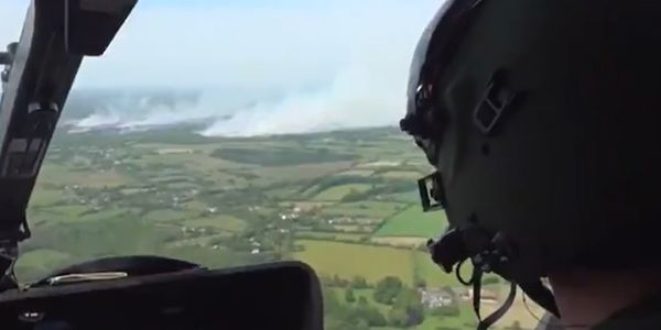 Smoke from a wildfire spreads across the Irish horizon.