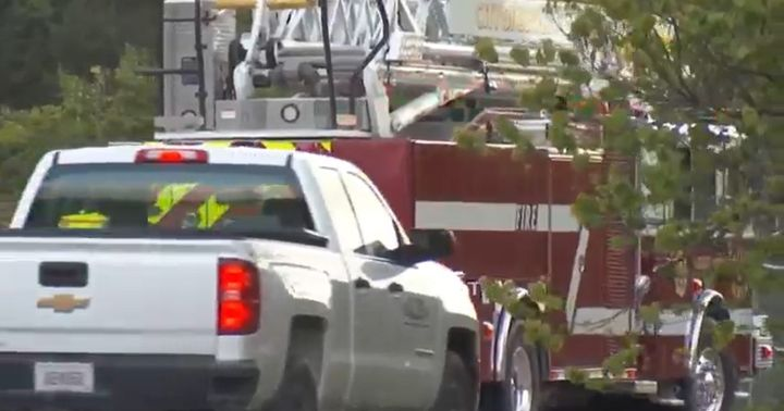 Emergency equipment arrives at Madison County, Kentucky, asphalt plant Sunday. - Screencapture Via Lex18