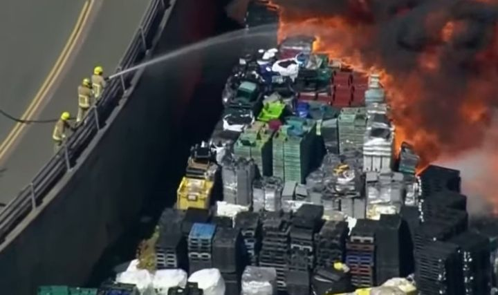 Firefighters attack burning plastic from a nearby roadway. - Screencapture Via BFM TV