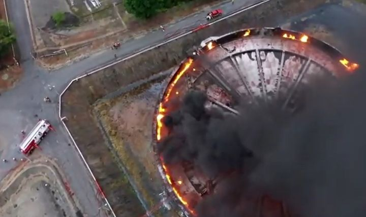 Drone video shows the seal burning on a crude oil storage tank in Port Dickson, Malaysia. - Screencapture Via YouTube