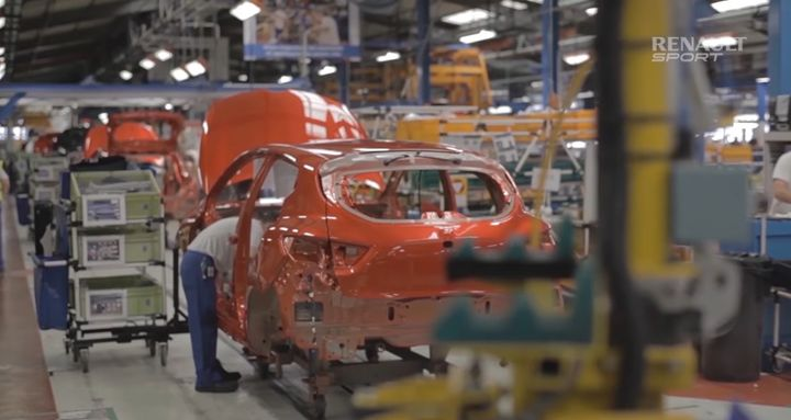 Cars move down the assembly line at a Renault plant in Dieppe, France. - Screencapture Via YouTube