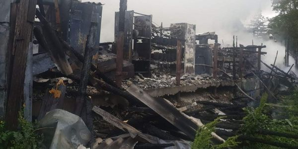 The gutted remains of a warehouse fire in Romania Tuesday that spread to neighboring homes.