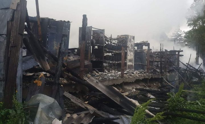 The gutted remains of a warehouse fire in Romania Tuesday that spread to neighboring homes. - Photo Courtesy of Iasi City Government