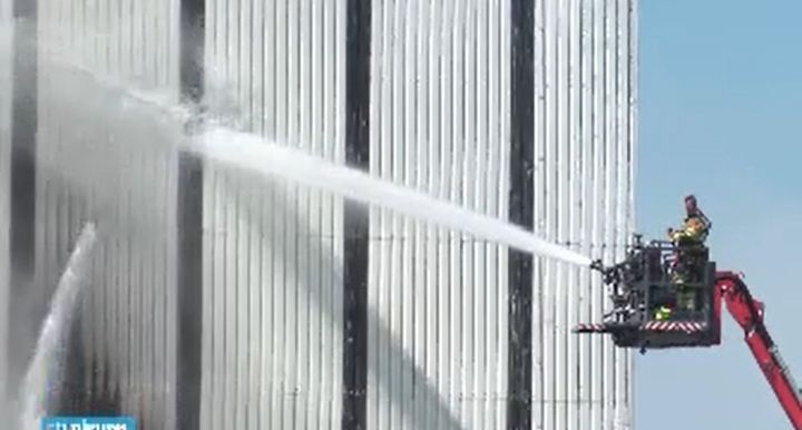 Aerial devices employed to battle fire at decommissioned nuclear plant in The Netherlands. - Screencapture Via RTL