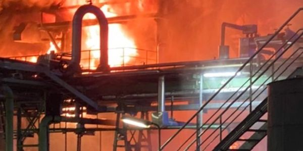 Flames rise behind a process unit at a German refinery Friday night.