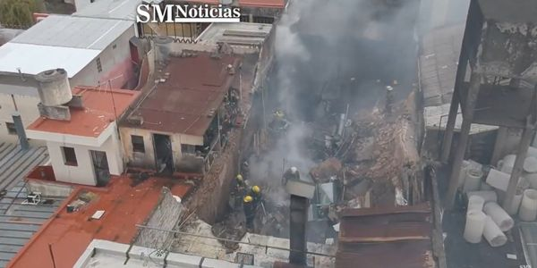 Firefighters overhaul a factory fire Monday in Argentina.