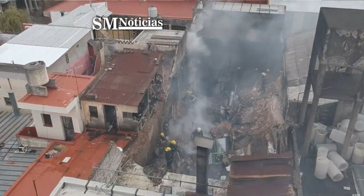 Firefighters overhaul a factory fire Monday in Argentina. - Screencapture Via SM Noticias
