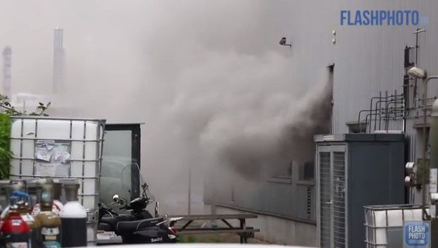 Thick smoke pours from an industrial laboratory in The Netherlands Monday. - Screencapture Via Flashphoto