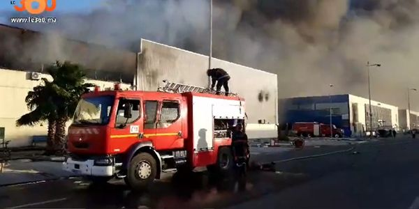 Billowing smoke rises from a burning factory in Morocco Saturday.