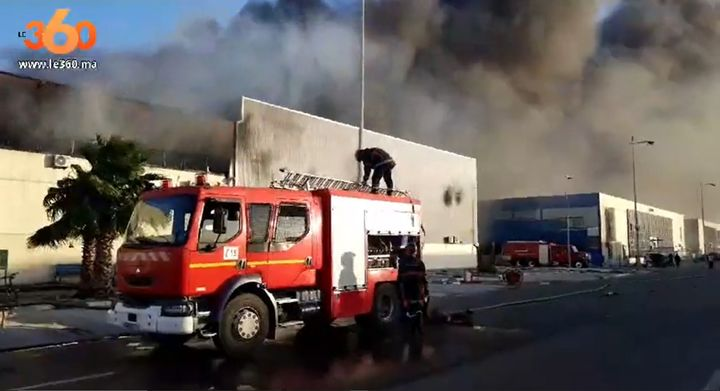 Billowing smoke rises from a burning factory in Morocco Saturday. - Screencapture Via Le 360