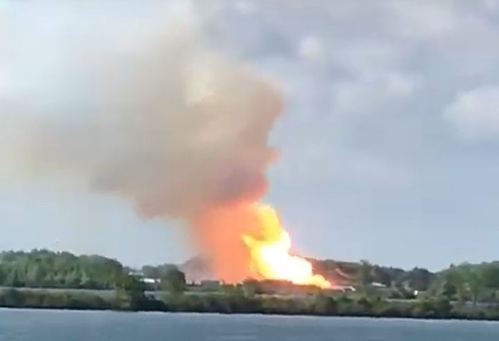 Photographer captures distant defense plant explosion Friday in Quebec province. - Screencapture Via YouTube