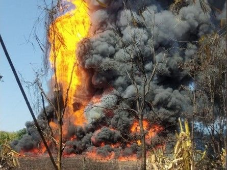 Flames engulf a leaking gas well in India. - Screencapture Via Rituparna Bhuyan