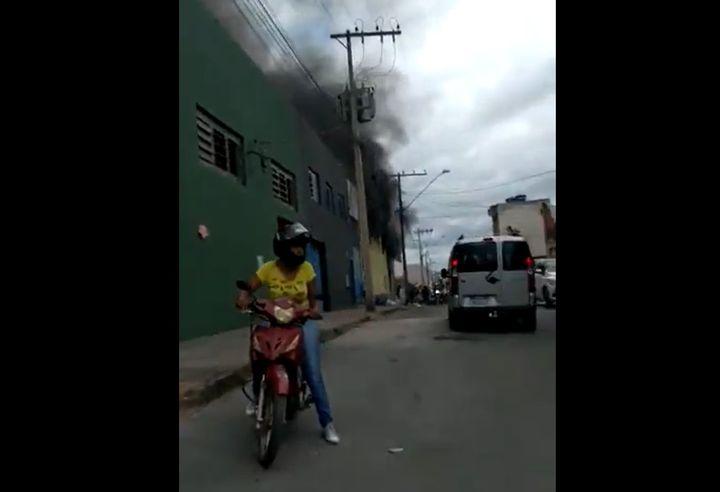 Smoke rises from a burning shoe factory in Nova Serrana, Brazil, Tuesday - Screencapture Via YouTube
