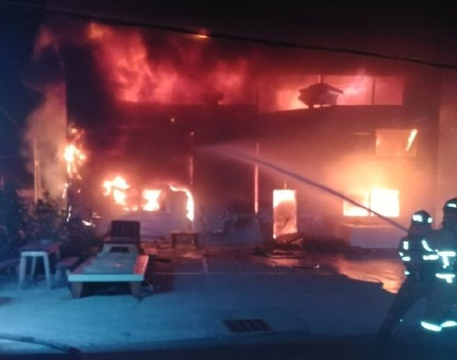 Flames engulf the interior of a wood processing plant Friday in Busan, South Korea. - Photo Courtesy of Busan Fire Department