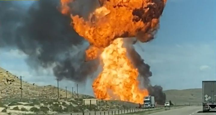 A fireball rises from a train derailment Saturday in Wyoming. - Screencapture Via YouTube