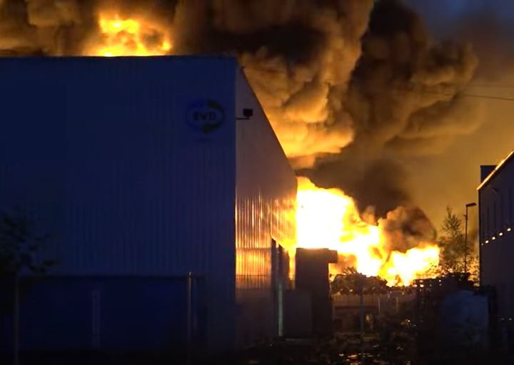 Billowing flames silouette surrounding buildings during a mammoth industrial fire in Diez, Germany, Wednesday. - Screencapture Via Wiesbaden 112