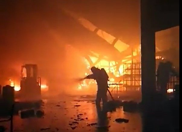 Firefighter make an interior attack on a chemical plant fire in Mexico Thursday. - Screencapture Via Bomberos de Nuevo Leon