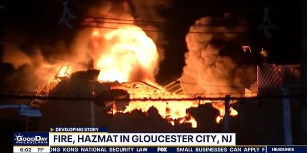 Flames sprout from an asphalt tank in New Jersey following an explosion Tuesday morning.