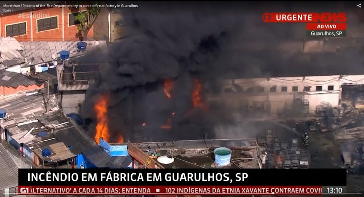 Aerial view of a burning chemical complex in Guarulhos, Brazil, Monday. - Screencapture Via Globo News